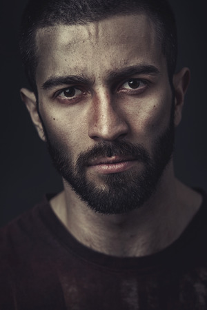 39040859 - portrait of a bearded man on dark background