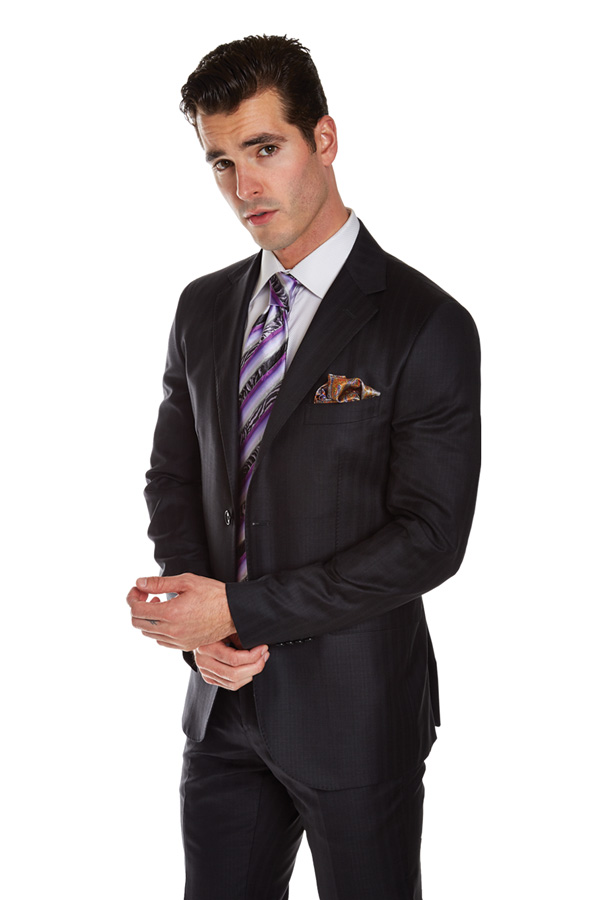 man wearing dark gray suit and purple striped tie