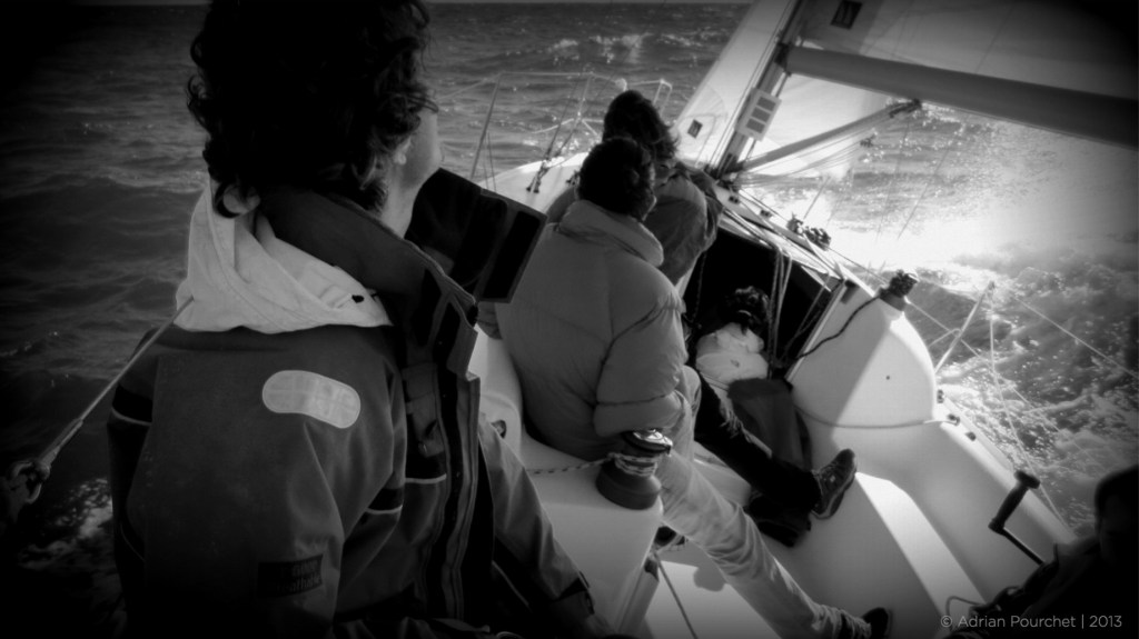Samba on Barcelona sailing day trips and tours, picture showing waves splashing over the foredeck. more wind.