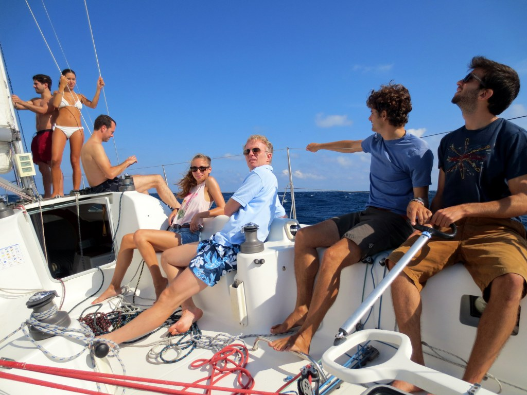 Day tour with Barcelona Sil happy people in swim suits sailing