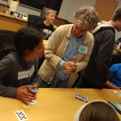 Here is one of our senior faculty members, Frances Stern, talking with a student about the mathematics of card tricks.