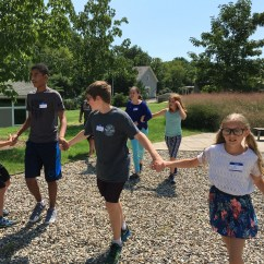 After lunch we have afternoon activities, which range from fun math to adventuring outside to participating in an active game. In this picture the students are playing a game of amoeba tag!