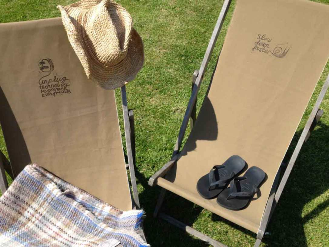 canvas deckchairs with Lino print graphics at barefoot glamping Cornwall