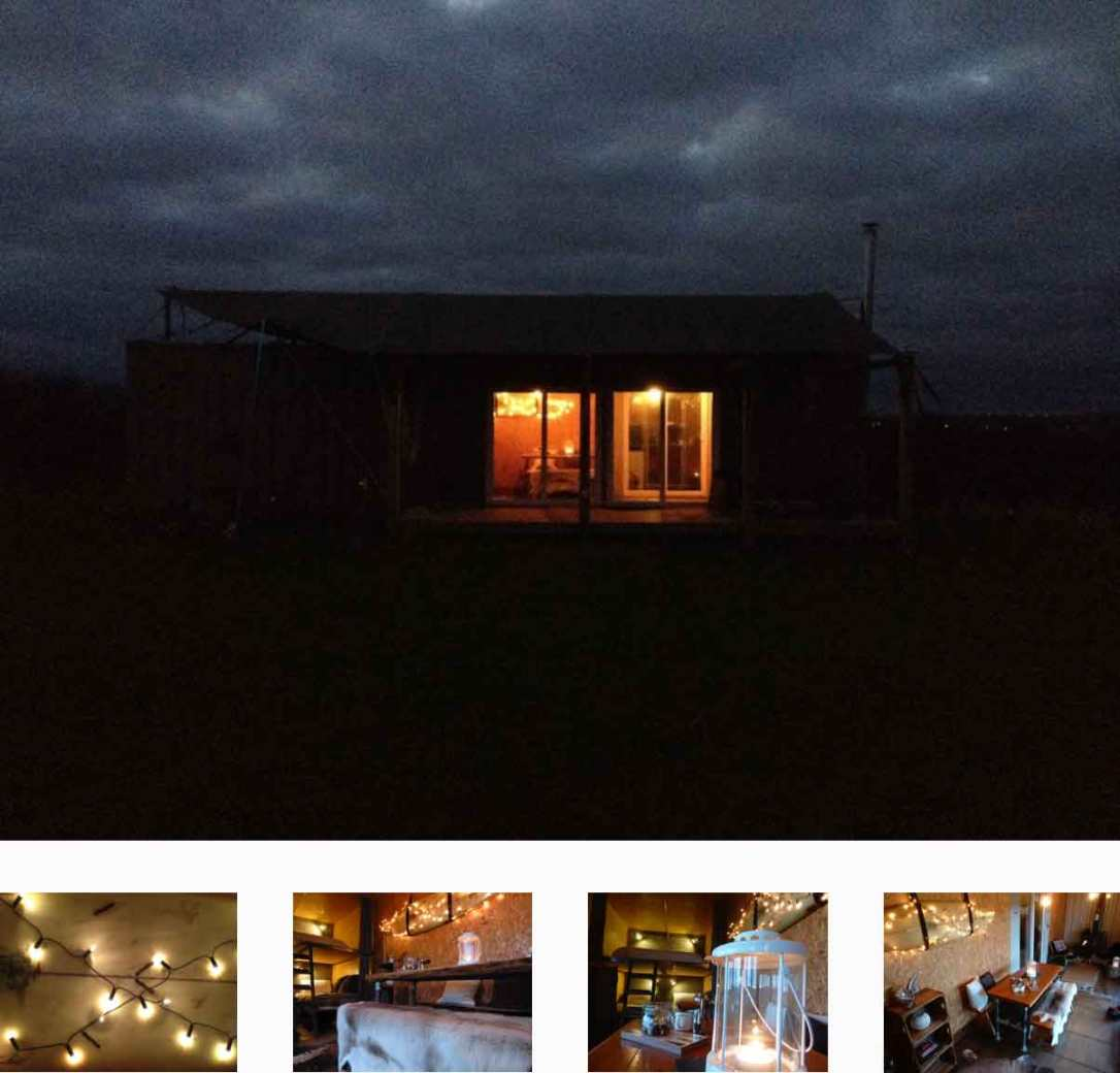rusty the tin tent converted shipping container at night at barefoot glamping Cornwall