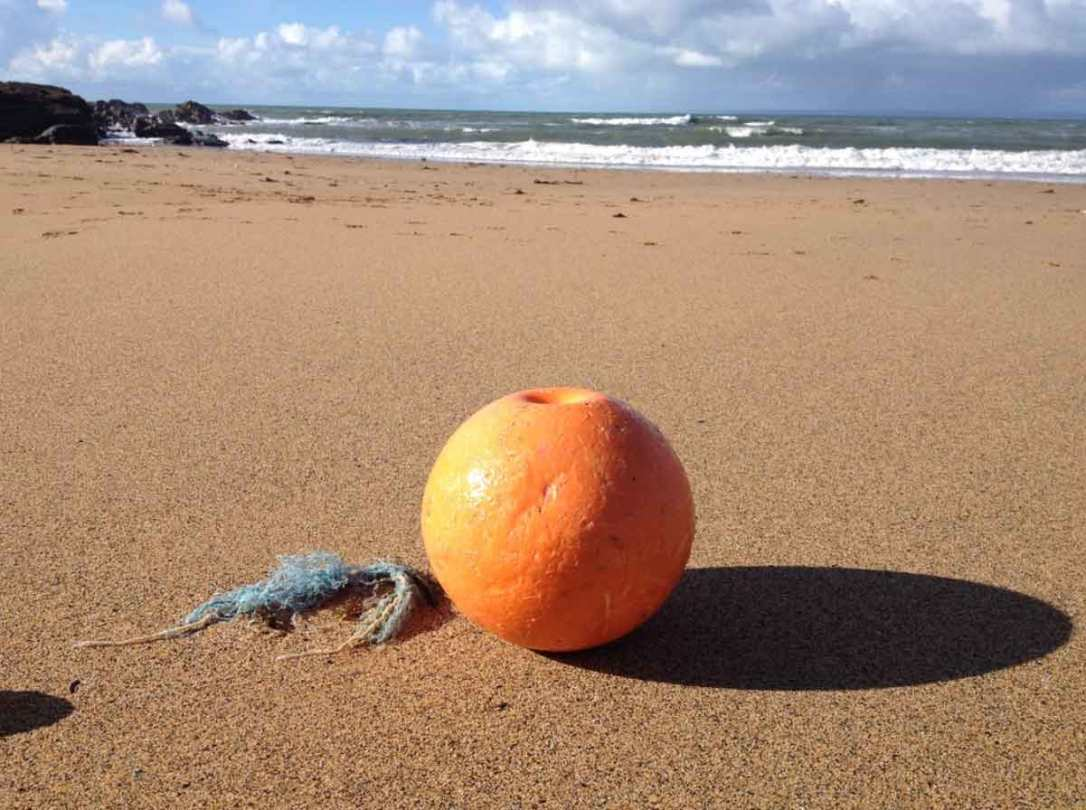 a washed up fishing bouy on the beach at nearby podhu cove Cornwall