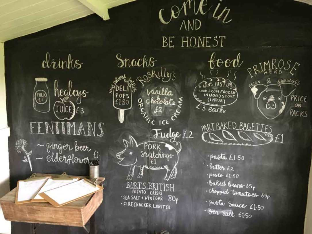 the chalk board menu in the honesty shop at barefoot glamping Cornwall