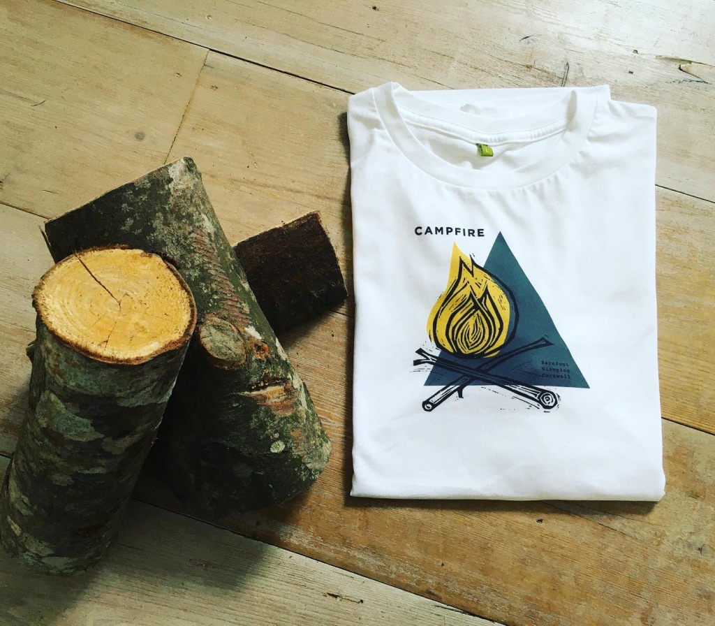 folded campfire t-shirt and logs
