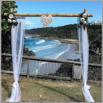 Wedding arbour decorated with white chiffon, peony flowers & wicker love heart. Point Perry Lookout, Coolum.