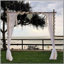 Wedding arbour with rustic love hearts & draping.