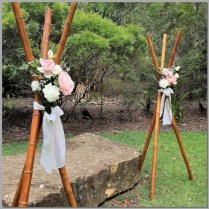 Wedding bamboo teepees with flowers.
