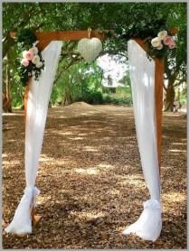 Timber wedding arbour styled with white chiffon, flowers/greenery & vintage love heart. Wirreanda Park, Buderim