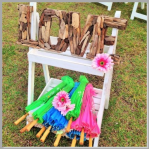 Beach stand and driftwood LOVE sign.