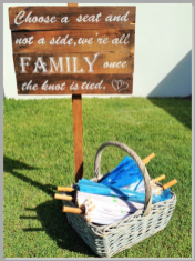 Wedding sign and basket of parasols.