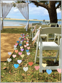 Hearts on stakes for wedding aisle.