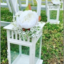 White lanterns styled with Peony flower and babies breath.