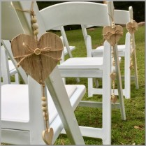 Hanging wooden love hearts for chair aisle decor.