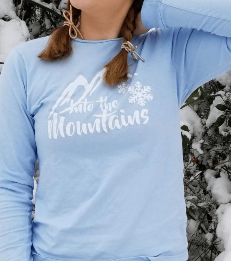 Into the Mountains Snowflake Tee Shop