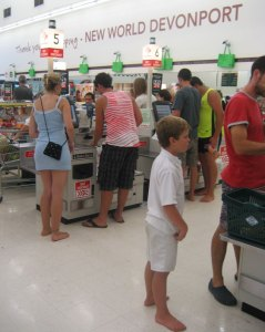 Adults and kids barefoot at checkout
