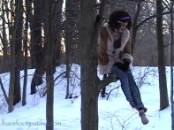 Barefoot Justine (Mara Andersen) in a tree one snowy day!