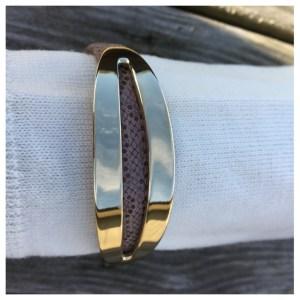 Skinnarmbånd med pynt i gullbelagt rustfritt stål