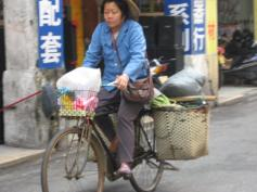 Woman on bike in Jiangmen