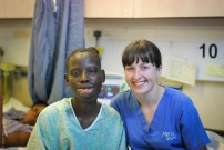 Nurse, Lynette Givan, with a patient on the wards.