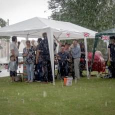 Downpour didn't dampen spirits at Queen's 90th Birthday Village Get Together