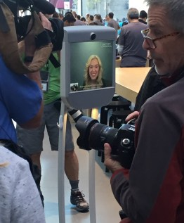 People queued through the night to get their hands on the latest handset. Including this robot lady person.