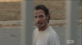 Rick passes by Deanna, makes eye contact with her, but neither one greets the other as Rick passes.