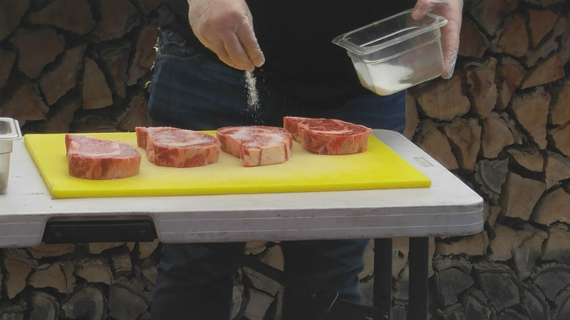 Salting the rib eyes