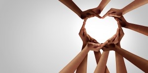 Ten different hands come together to form the shape of a heart. Representing unity, diversity, partnership, connection, support, teamwork, and togetherness.