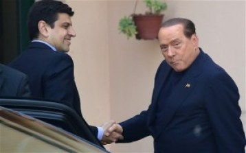 Silvio Berlusconi arrives for his first day's community service