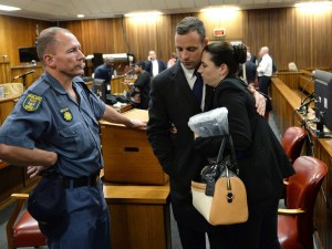 Oscar Pistorius hugs his sister on the second day of his murder trial