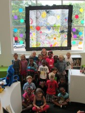 Ms. Kelly's K class posed with their mural