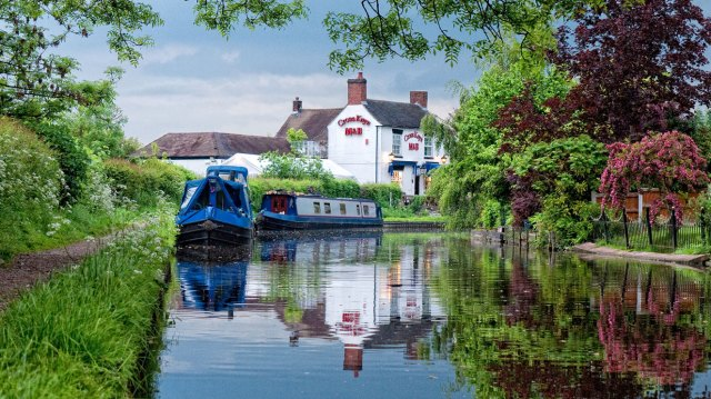 A quintessential canal image - narrowboats and a country pub
