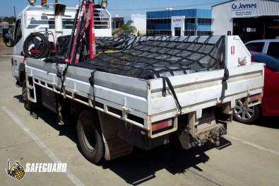 Truck with cargo net over Tool boxes