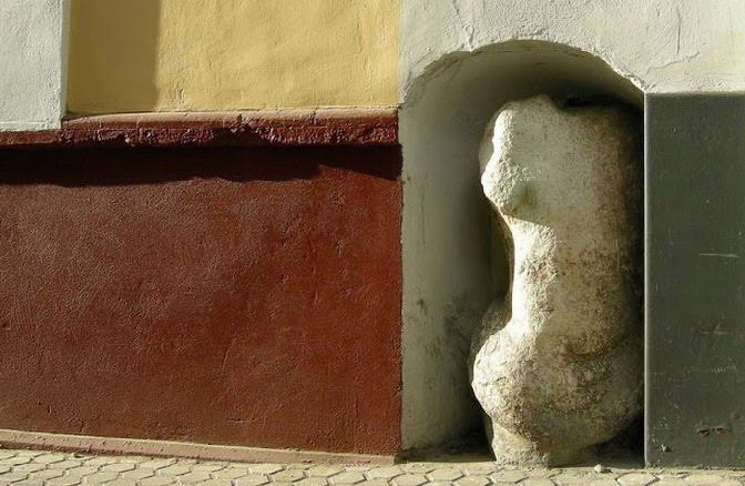 curiosities in seville man of stone