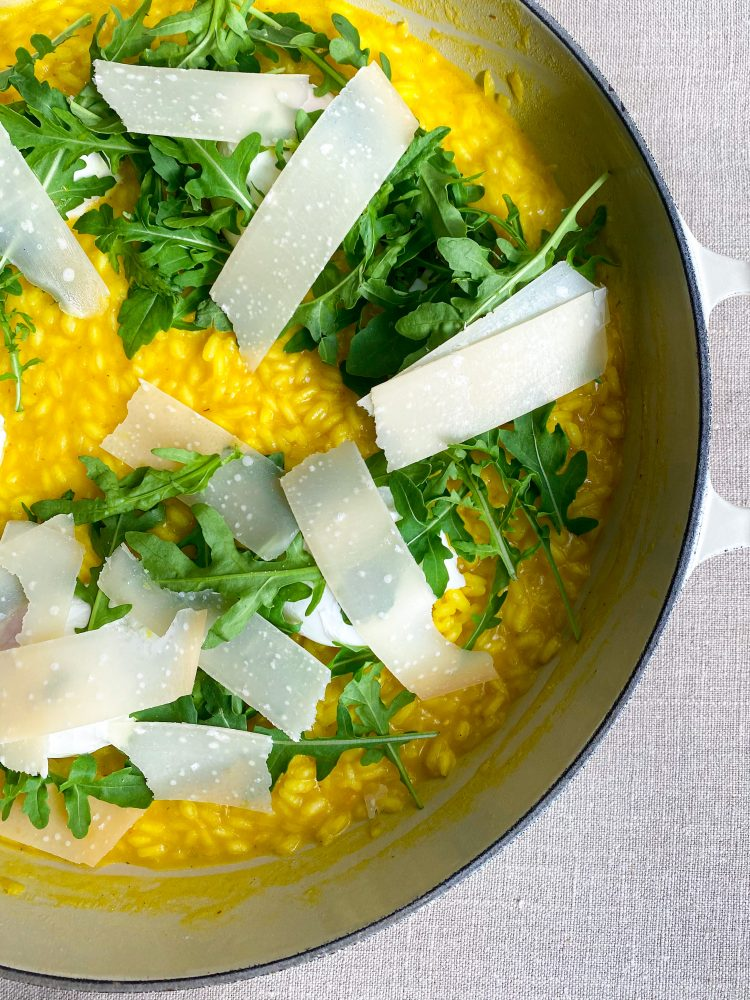 Saffron risotto with poached eggs and rocket