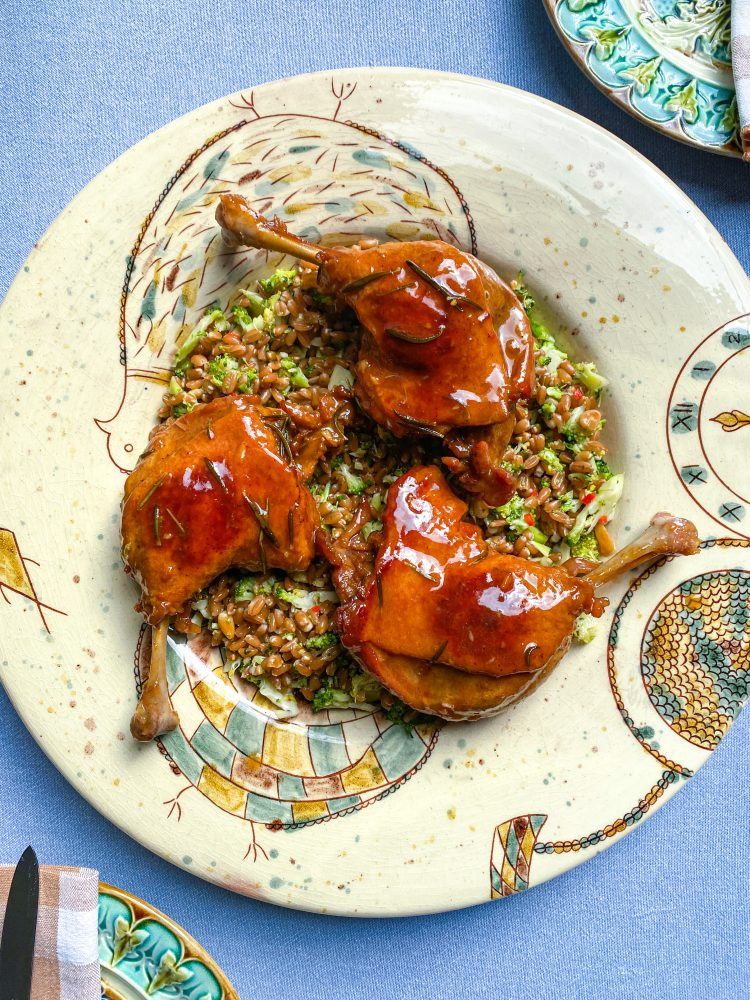 Duck legs with quince jus, spelt with broccoli and pine nuts