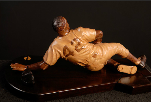 "Stealing Home (6"" x 24"" Mahogany sculpture on Mahogany base)"