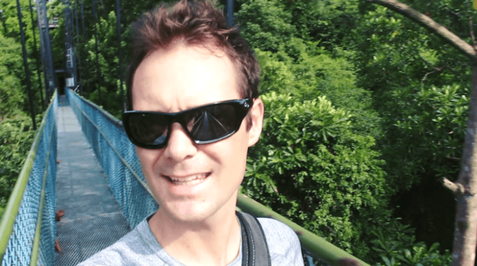 Listening To Birds Sing On MacRitchie Reservoir TreeTop Walk Bridge