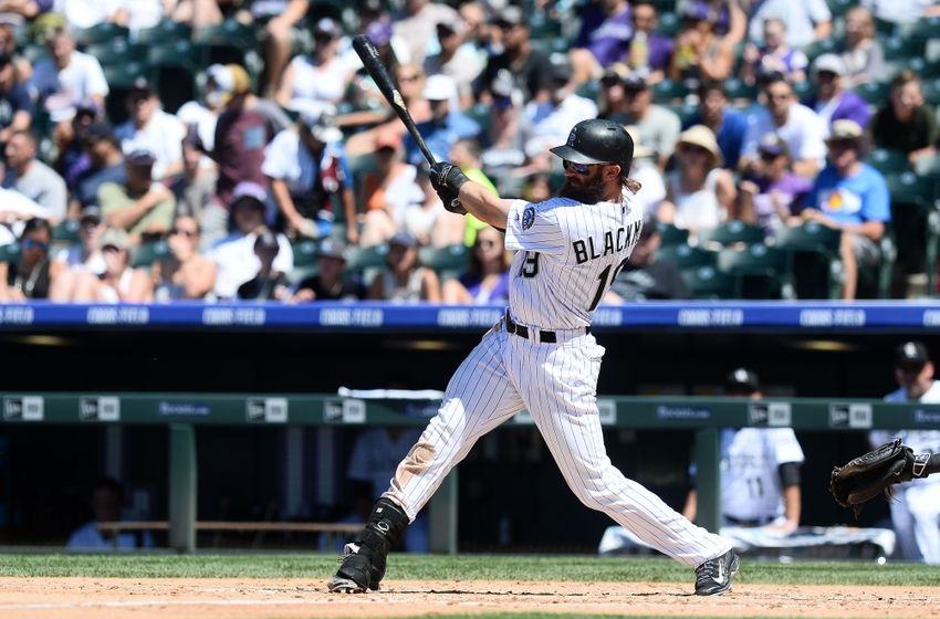 Jun 26, 2016; Denver, CO, USA; Colorado Rockies center fielder Charlie Blackmon (19) hits a solo home run in the third inning at against the Arizona Diamondbacks Coors Field. Mandatory Credit: Ron Chenoy-USA TODAY Sports