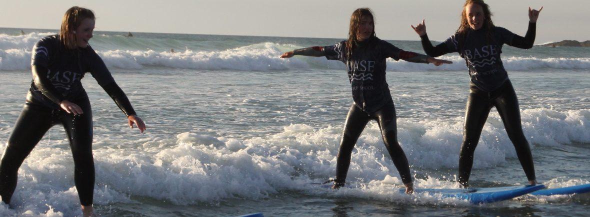 surfing girls at sunset