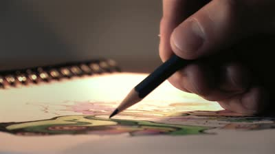 stock-footage-artist-sketching-with-pencils-in-sketchpad-close-up