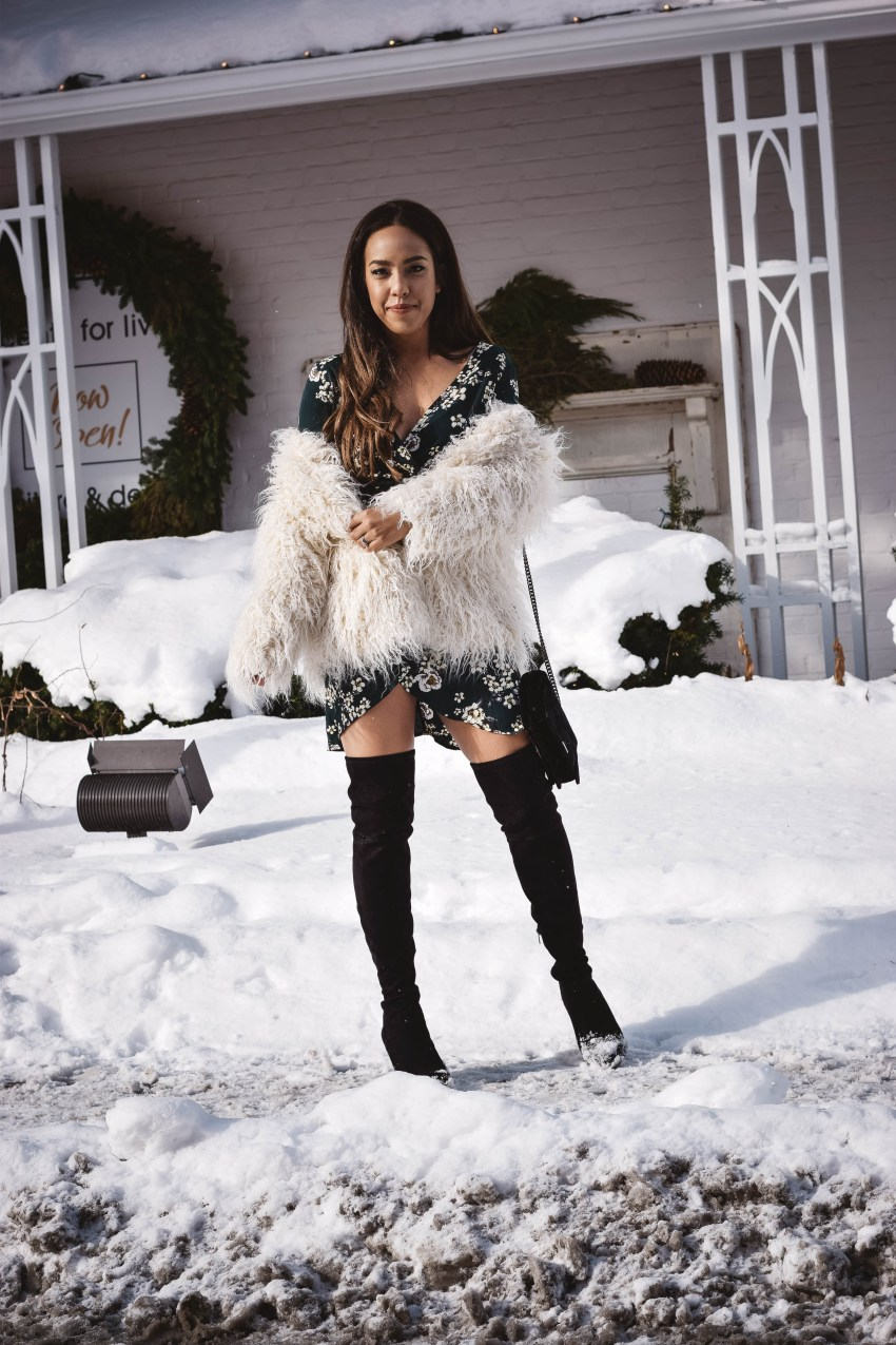 Fashion blogger Lauren Sheriff of Basic Babe in H&M Fur Jacket and Shein Floral Wrap Dress, Marc Fisher Over the Knee Boots, Rebecca Minkoff Velvet Purse