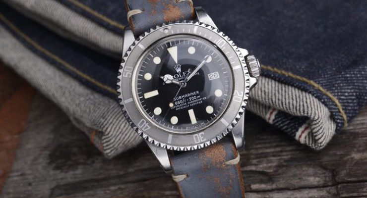 rolex-on-grey-leather