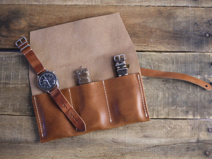 Omega speedmaster on an English Tan strap and our 3 slot watch roll - Choice cuts Industries