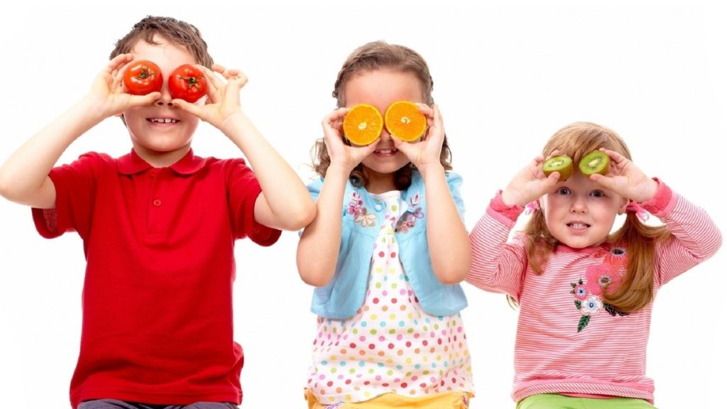 Kids playing with fruit