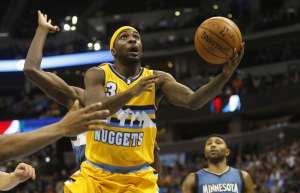 Dec 26, 2014; Denver, CO, USA; Denver Nuggets guard Ty Lawson (3) shoots the ball during the second half against the Minnesota Timberwolves at Pepsi Center.  The Nuggets won 106-102.  Mandatory Credit: Chris Humphreys-USA TODAY Sports