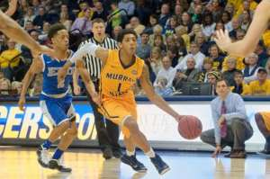 Murray State's Cameron Payne drives past Eastern Illinois' Cornell Johnston during the second half of an NCAA college basketball game Thursday, Feb. 26, 2015, in Murray, Ky. (AP Photo/Murray Ledger & Times, Kyser Lough)
